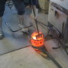 Molten bronze being ready for casting